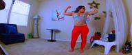 Flexing in fitness leggings